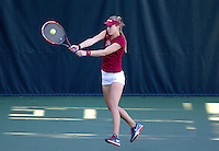 STANFORD, CA - MARCH 1, 2015--Stanford women tennis player Krista Hardebeck, returns the ball back to a CAL Berkley player during Sunday's match at the Taube Family Tennis Stadium.