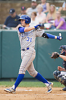 Riley King (31) of the Burlington Royals follows through on his swing against the Pulaski Mariners at Calfee Park on June 20, 2014 in Pulaski, Virginia.  The Mariners defeated the Royals 6-4. (Brian Westerholt/Four Seam Images)