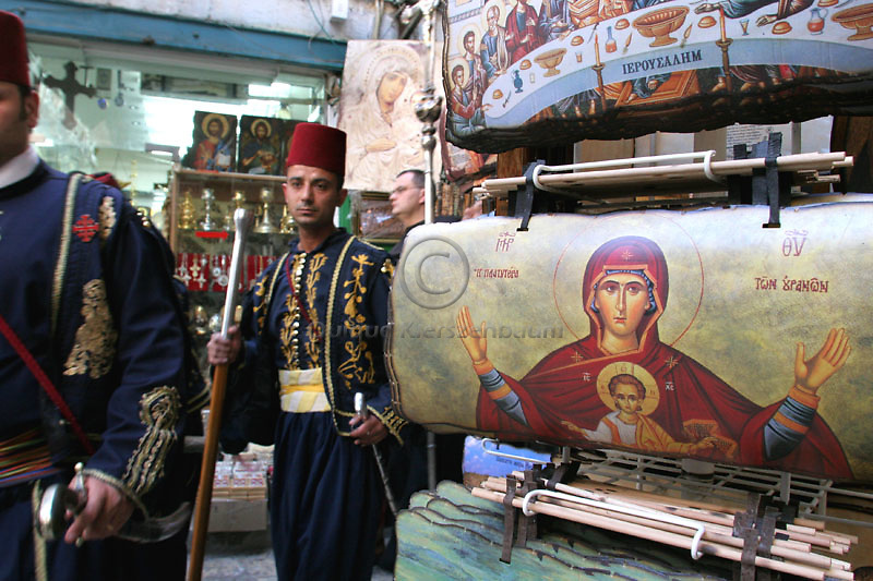 A Christian procession walks by the market of the Christian Quarter, in the Old City of Jerusalem. Photo by Quique Kierszenbaum