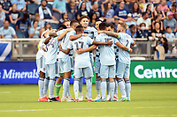 KANSAS CITY, KS - JULY 31: Sporting KC players in a pre match huddle during a game between FC Dallas and Sporting Kansas City at Children's Mercy Park on July 31, 2021 in Kansas City, Kansas.