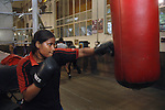 INDIA (West Bengal - Calcutta)July 2007, Sanno Babe at practice at Sports Authority of India Complex (East Zone) in Kolkata. Shakila and Shanno are twins from a poor muslim family of Iqbalpur, Kolkata. . Inspite of their late father's unwillingness to send his daughters to take up  boxing her mother Banno Begum inspired them to take up boxing at the age of 3. Their father was more concerned about the social stigma they have in their community regarding women coming into sports or doing anything which may show disrespect to the religious emotions of his community. Shakila now has been recognised as one of the best young woman boxers of the country after she won the  international championship at Turkey in the junior category. Shanno is also been called for the National camp this year. Presently Shakila and shanno has become the role model in the Iqbalpur area  and parents from muslim community of Iqbalpur have started showing interst in boxing. Iqbalpur is a poor muslim dominated area mostly covered with shanty town with all odds which comes along with poverty and lack of education. - Arindam Mukherjee