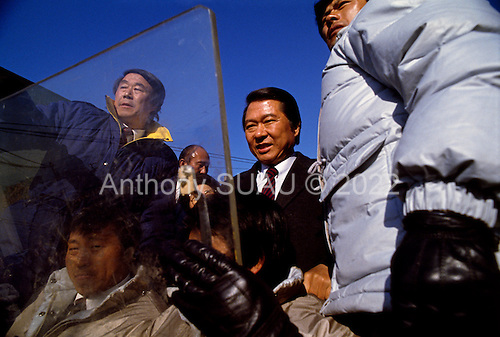 """Seoul, South Korea<br /> December 13 1987<br /> <br /> Massive crowds cheer for Kim Dea-jong, the opposition leader to the ruling party campaigning during the South Korean presidential elections in Seoul's Poramae Park. <br /> <br /> Kim Dae-jung (3 December 1925 to 18 August 2009) was President of South Korea from 1998 to 2003, and the 2000 Nobel Peace Prize recipient. As of this date Kim is the first and only Nobel laureate to hail from Korea. A Roman Catholic since 1957, he has been called the """"Nelson Mandela of Asia"""" for his long-standing opposition to authoritarian rule."""