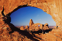 Turret Arch seen through North Window at sunrise with Tourists, Arches National Park, Utah, USA, September 2007