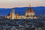 It was a hot, hazy day ending in a boring sunset. Your'e best chance is to photograph at just the right time - when the lights first come on and there's still detail in the surroundings. The Duomo Cathedral at sunset, Florence, Italy.