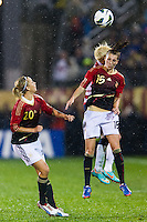 Verena Faisst (15) of Germany (GER) goes up for a header with Megan Rapinoe (15) of the United States (USA). The United States (USA) and Germany (GER) played to a 2-2 tie during an international friendly at Rentschler Field in East Hartford, CT, on October 23, 2012.