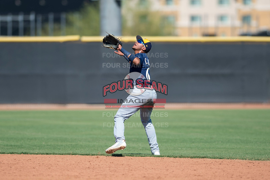 Milwaukee Brewers second baseman Daniel Castillo (65) prepares to catch a pop fly during an Instructional League game against the San Diego Padres at Peoria Sports Complex on September 21, 2018 in Peoria, Arizona. (Zachary Lucy/Four Seam Images)