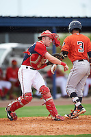 GCL Nationals catcher Joey Harris (4) throws down as Gilberto Celestino (3) bats during a game against the GCL Astros on August 14, 2016 at the Carl Barger Baseball Complex in Viera, Florida.  GCL Nationals defeated GCL Astros 8-6.  (Mike Janes/Four Seam Images)