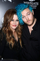"""12 July 2020 - Benjamin Keough, Son of Lisa Marie Presley and Grandson of Elvis Presley, Dead at 27 From Apparent Suicide. File photo: 23 April 2015 - Las Vegas, Nevada - Lisa Marie Presley, Benjamin Keough. Red Carpet Premiere of """"The Elvis Experience"""" Musical Production at The Westgate Las Vegas Resort and Casino. Photo Credit: MJT/AdMedia"""