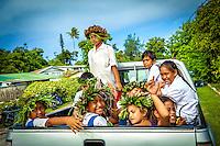 Kids with leafy headbands during the celebration of Makirau Haurua's investiture with the Teurukura Ariki title, Aitutaki Island, Cook Islands.