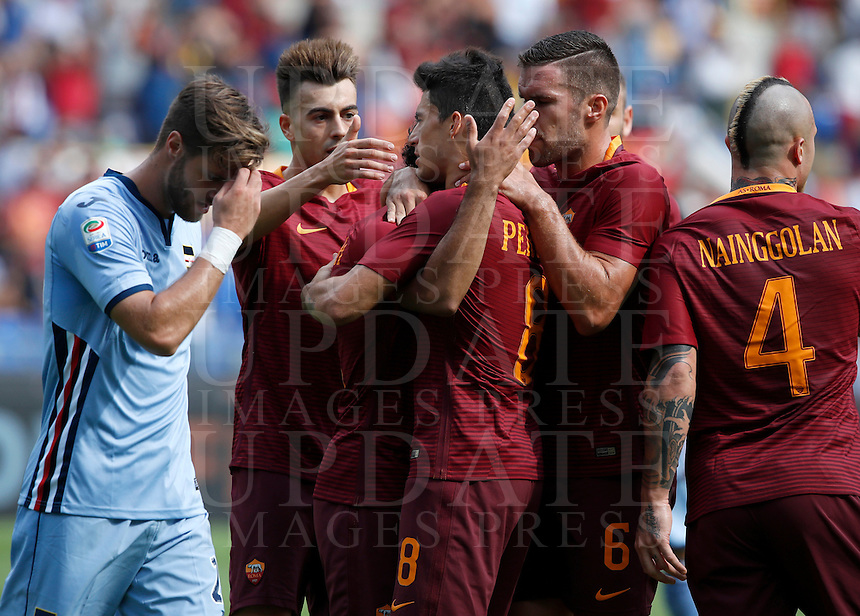 Calcio, Serie A: Roma vs Sampdoria. Roma, stadio Olimpico, 11 settembre 2016.<br /> Roma's Mohamed Salah, third from left, partially seen, celebrates with teammates after scoring during the Italian Serie A football match between Roma and Sampdoria at Rome's Olympic stadium, 11 September 2016. Roma won 3-2.<br /> UPDATE IMAGES PRESS/Isabella Bonotto