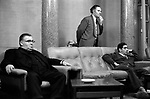 Three men watching TV in the lobby of a London hotel 1970s UK