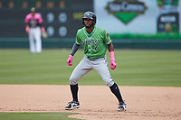 Travis Demeritte (12) of the Gwinnett Stripers takes his lead off of first base against the Charlotte Knights at Truist Field on May 9, 2021 in Charlotte, North Carolina. (Brian Westerholt/Four Seam Images)