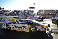 Feb. 17 2012; Chandler, AZ, USA; NHRA pro stock driver Rodger Brogdon (near lane) races alongside Shane Gray during qualifying for the Arizona Nationals at Firebird International Raceway. Mandatory Credit: Mark J. Rebilas-