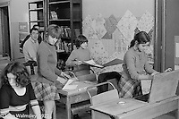Moving into the classroom, Scotland Road Free School, Liverpool  1971, John Ord in the background.  Also known as the Scotland Road or Scottie Road Free School it was founded and run by two teachers, John Ord and Bill Murphy (if I've got these names wrong, please tell me!) who worked with truanting kids and provided somewhere to go and things to do.  They begged and borrowed an old building, desks, books and an old ambulance for trips.