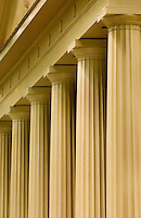 Large columns outside of a chapel on the campus of Queens University in the Myers Park neighborhood in Charlotte, NC. Myers Park is one of the premier neighborhoods in North America and known for its large canopy of trees.