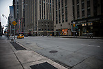 Empty streets and sidewalks are seen along 6th Avenue in New York, U.S., on Thursday, March 19, 2020. New York state Governor Andrew Cuomo on Thursday ordered businesses to keep 75% of their workforce home as the number of coronavirus cases rises rapidly. Photograph by Michael Nagle/Redux