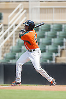 Anfernee Seymour (12) of the Greensboro Grasshoppers follows through on his swing against the Kannapolis Intimidators at Intimidators Stadium on July 17, 2016 in Greensboro, North Carolina.  The Intimidators defeated the Grasshoppers 3-2 in game one of a double-header.  (Brian Westerholt/Four Seam Images)