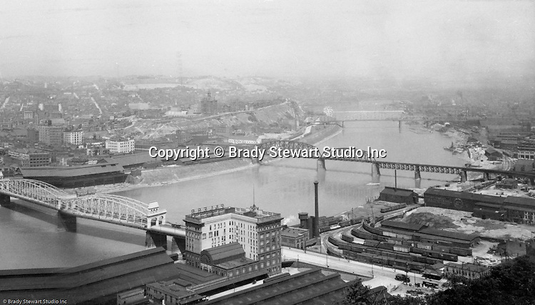 Pittsburgh PA - View of the PL&E Railroad Building (Pennsylvania and Lake Erie Railroad) and yard, Smithfield Street Bridge, Monongahela Railroad Bridge, and Mon warehouses from Mount Washington.