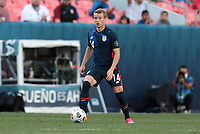 DENVER, CO - JUNE 3: Jackson Yueill #14 of the United States looks for an open man downfield during a game between Honduras and USMNT at EMPOWER FIELD AT MILE HIGH on June 3, 2021 in Denver, Colorado.