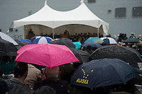 130504-N-DR144-488 ANCHORAGE, Alaska (May 4, 2013)- Guests brave snow and cold to attend the commissioning of San Antonio-class amphibious transport dock ship USS Anchorage (LPD 23) at the Port of Anchorage. More than 4,000 people gathered to witness the ship's commissioning in its namesake city of Anchorage, Alaska. Anchorage, the seventh San Antonio-class LPD, is the second ship to be named for the city and the first U.S. Navy ship to be commissioned in Alaska. (U.S. Navy photo by Mass Communication Specialist 1st Class James R. Evans / RELEASED)