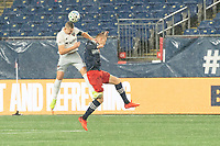 FOXBOROUGH, MA - NOVEMBER 1: Russell Canouse #4 of DC United and Adam Buksa #9 of New England Revolution compete for a high ball during a game between D.C. United and New England Revolution at Gillette Stadium on November 1, 2020 in Foxborough, Massachusetts.