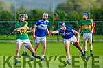 Darragh Conway of Lixnaw about to be  blocked by Keith  O'Mahony from St Brendans in the County Minor Hurling championship quarter final on Friday.