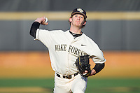 Wake Forest Demon Deacons starting pitcher Jack Fischer (15) in action against the Towson Tigers at Wake Forest Baseball Park on February 15, 2014 in Winston-Salem, North Carolina.  The Tigers defeated the Demon Deacons 5-4.  (Brian Westerholt/Four Seam Images)