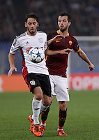 Calcio, Champions League, Gruppo E: Roma vs Bayer Leverkusen. Roma, stadio Olimpico, 4 novembre 2015.<br /> Bayer Leverkusen's Hakan Calhanoglu, left, is challenged by Roma's Miralem Pjanic during a Champions League, Group E football match between Roma and Bayer Leverkusen, at Rome's Olympic stadium, 4 November 2015.<br /> UPDATE IMAGES PRESS/Isabella Bonotto