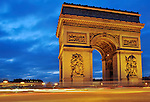 The Arc de Triomphe at night in Paris, France.