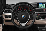 Car pictures of steering wheel view of a 2018 BMW 3 Series Touring 330i xDrive 5 Door Wagon