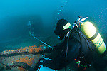 Divers taking offset measurements from a baseline near the Scotch Boiler. (Photo by Shane Wasik Photography)