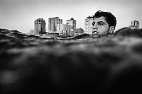 Surfer Hatem Krazem (24) paddles out into the Meditteranean Sea from Gaza City.