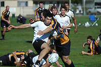 Colorado State University's full back clears the ball away from the 22 as a NAVY player charges him down in the closing moments of the match between the two rugby teams during the San Diego Invitational Tournament at Rob Field in Ocean Beach, San Diego, Thursday February 7 2008.  Navy won the match 17 -10 with a late converted try.  The tournament is being held  in conjunction with the USA 7?s International Rugby at PETCO Park on February 9th & 10th.