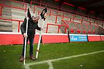 © Joel Goodman - 07973 332324 . 14/11/2015 . Manchester , UK . Groundsman GRAHAM BYRNE planting corner flags ahead of the match . FC United host Gainsborough Trinity in the National League North at Broadhurst Park . NB requested changing room access three times and was denied three times . Photo credit : Joel Goodman