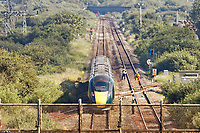 Pictured: The stranded train on the tracks near Margam in south Wales, UK. Wednesday 03 July 2019<br /> Re: Two rail workers have died after being hit by a passenger train between Port Talbot Parkway and Bridgend stations in south Wales, UK.<br /> The pair were struck near Margam by the Swansea to London Paddington train at about 10am.<br /> They were pronounced dead at the scene and a third person was treated for shock, but was not injured.