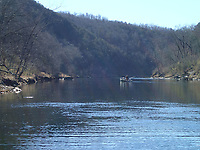 Boats suitable for lake fishing can easily navigate the lower stretch of White River, between the U.S. 62 bridge and Houseman Access. Anglers fish here about one mile upstream from Houseman.<br />(NWA Democrat-Gazette/Flip Putthoff)