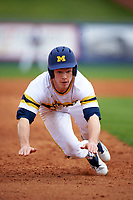Michigan Wolverines left fielder Matt Ramsay (46) slides head first into third base during the first game of a doubleheader against the Canisius College Golden Griffins on June 20, 2016 at Tradition Field in St. Lucie, Florida.  Michigan defeated Canisius 6-2.  (Mike Janes/Four Seam Images)