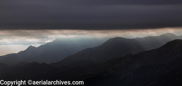 aerial photograph of light rays breaking through a layer of fog at the Santa Lucia Mountains, Santa Barbara County, California