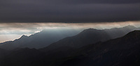 aerial photograph of light rays breaking through a layer of fog at the Santa Lucia Mountains, Santa Barbara County, California