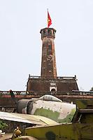 Vietnam. Hanoi. Military history museum. A vistor near a Douglas A-1H Skyraider USAF air plane. A military aircraft taken by north vietnamese troops during the war against USA. 04.04.09 © 2009 Didier Ruef