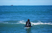 A surfer at Lyall Bay. 1pm, Wednesday as New Zealand (outside of Auckland) switches down to Level 3 lockdown for the COVID-19 pandemic in Wellington, New Zealand on Wednesday, 1 September 2021.