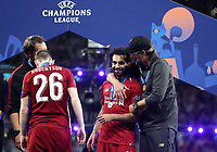 Liverpopol's coach Jurgen Klopp, right, hugs his player Mohamed Salah at the end of the UEFA Champions League final football match between Tottenham Hotspur and Liverpool at Madrid's Wanda Metropolitano Stadium, Spain, June 1, 2019. Liverpool won 2-0.<br /> UPDATE IMAGES PRESS/Isabella Bonotto