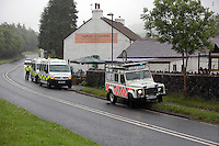 Pictured: Ambulances on stand by at Tafarn y Gerreg in Powys, Wales UK. Wednesday 29 June 2016<br />Re: Rescuers have found a number of the 24 children who went missing the Brecon Beacons.<br />Dyfed-Powys Police said a Coastguard helicopter had found some the children, who are from St Albans, Hertfordshire.<br />The helicopter has landed and the crew are with the children, but their condition is not known.<br />The alarm was raised at about 13:00 BST after the groups went missing around Llyn y Fan Fach, near Abercraf.<br />The children are in their mid teens and were on the beacons as part of their Duke of Edinburgh Award.<br />Mark Moran from Central Beacons Mountain Rescue said his team had been in intermittent phone contact with the four groups of six children before the first group were found.