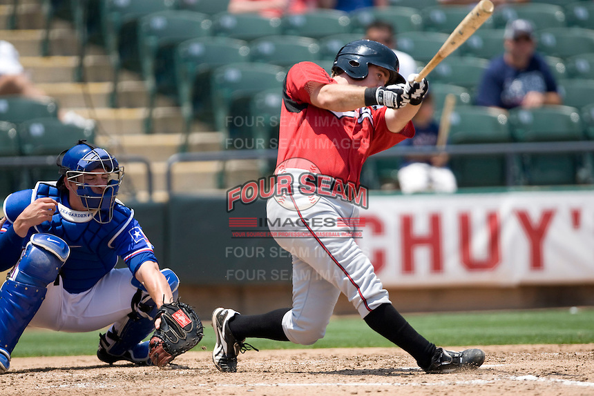Nashville Sounds third baseman Taylor Green #3 swings against the Round Rock Express in Pacific Coast League baseball on May 9, 2011 at the Dell Diamond in Round Rock, Texas. (Photo by Andrew Woolley / Four Seam Images)