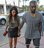 MIAMI, FL - OCTOBER 08:  Kim Kardashian is said to be devastated that her ex, Reggie Bush is expecting a baby with his girlfriend, Lilit Avagyan She was seen today walking in the rain hand and hand in Miami house hunting with boyfriend Kanye West . on October 8, 2012 in Miami, Florida.<br /> <br /> People:  Kim Kardashian_Kanye West<br /> <br /> Transmission Ref:  MNC4<br /> <br />  Credit: Hoo-Me.com/MediaPunch