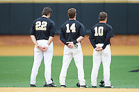 Will Craig (22), Conor Keniry (14) and Nate Mondou (10) stand for the National Anthem prior to the game against the Florida State Seminoles at Wake Forest Baseball Park on April 19, 2014 in Winston-Salem, North Carolina.  The Seminoles defeated the Demon Deacons 4-3 in 13 innings.  (Brian Westerholt/Four Seam Images)