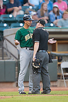 Lynchburg Hillcats manager Mark Budzinski (7) argues a call with home plate umpire Chase Eade during the game against the Winston-Salem Dash at BB&T Ballpark on May 29, 2015 in Winston-Salem, North Carolina.  The Dash defeated the Hillcats 8-1.  (Brian Westerholt/Four Seam Images)