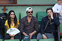 Reem Kherici and Raphael Personnaz seen watching tennis during Roland Garros tennis open 2016 on may 27 2016.