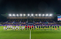 ORLANDO, FL - JANUARY 18: The USWNT and Colombia stand on the field before the national anthem during a game between Colombia and USWNT at Exploria Stadium on January 18, 2021 in Orlando, Florida.