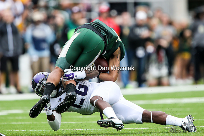 Baylor Bears wide receiver Levi Norwood (42) and TCU Horned Frogs safety Derrick Kindred (26) in action during the game between the TCU Horned Frogs and the Baylor Bears at the McLane Stadium in Waco, Texas. TCU leads Baylor 31 to 27 at halftime.